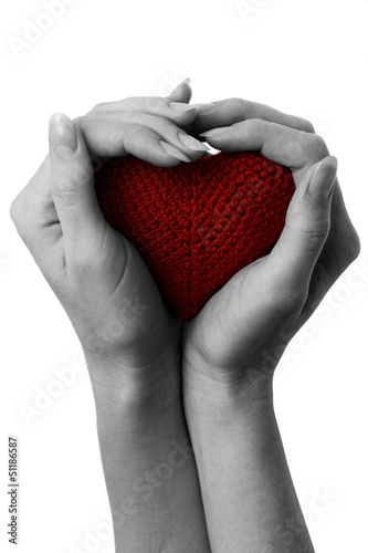 Fotobehang Rood, zwart, wit Red heart in cupped hands.