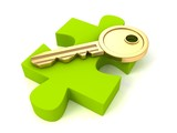 Golden key of success on green puzzle piece