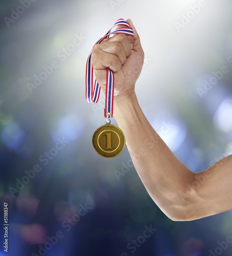 hand and gold mmedal