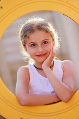 Summer joy - lovely girl on playground
