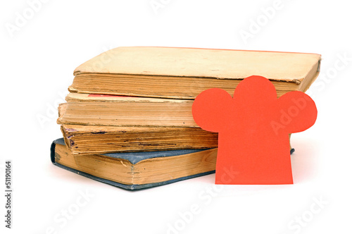paper shape chef hat on stack books