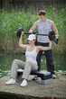 Detaily fotografie woman exercising with personal trainer with barbell - outdoor
