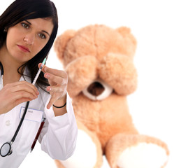 young doctor with stethoscope and syringe