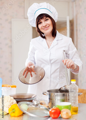 cook woman with ladle