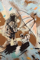 graffiti on Rome's public wall girl with umbrella and dog