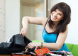 positive woman  finding anything  in purse