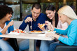 Young people having lunch in restaurant