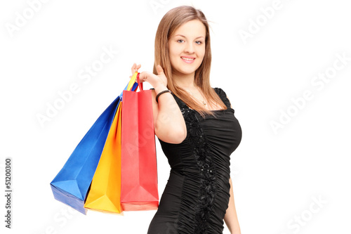 A young female holding shopping bags