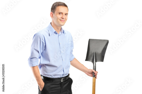 A young man holding a shovel
