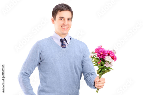 A young romantic man holding a bouquet of flowers