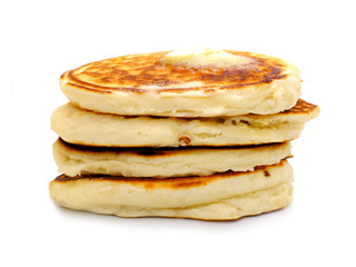 Stack of fresh breakfast pancakes over white