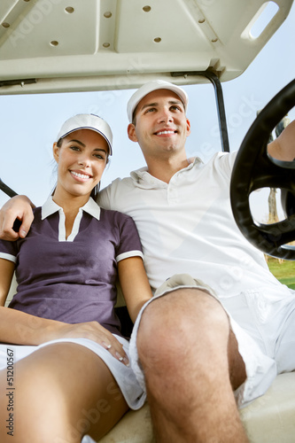 Young couple on golf