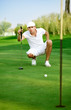 Young golfer lining up a putt