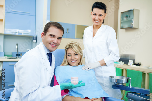 Dentist showing dental mold