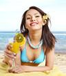 Girl in bikini drink juice through a straw.