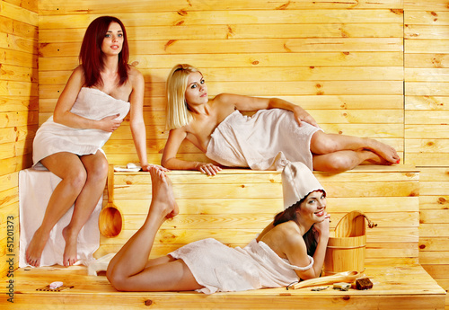 Woman relaxing in sauna.