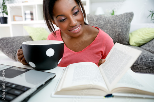 Young African student learning at home