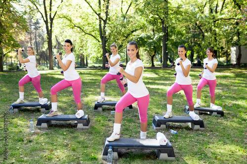 women doing fitness exercises in park