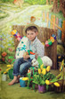 Easter theme with small boy with toy bunnies, chicks and eggs