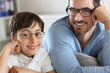 Portrait of young boy with daddy with eyeglasses on