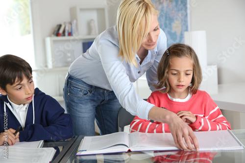 Children sitting in classroom with teacher