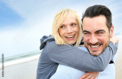 Cheerful couple standing on the beach