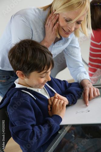 Teacher with kid in classroom
