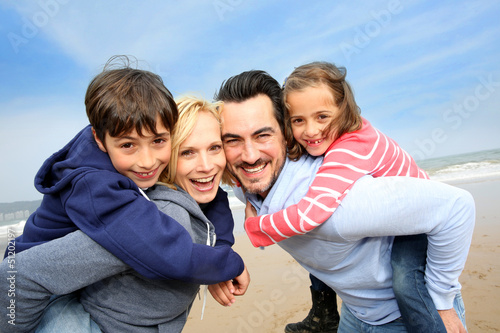Portrait of cheerful family at the beach