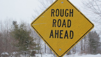 Rough road ahead. Light snow falling. Ontario.