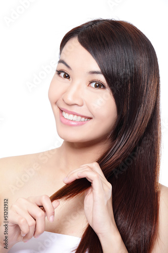 young woman happy touch her hair