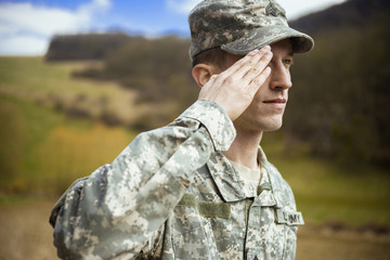 Male army soldier in the uniform saluting