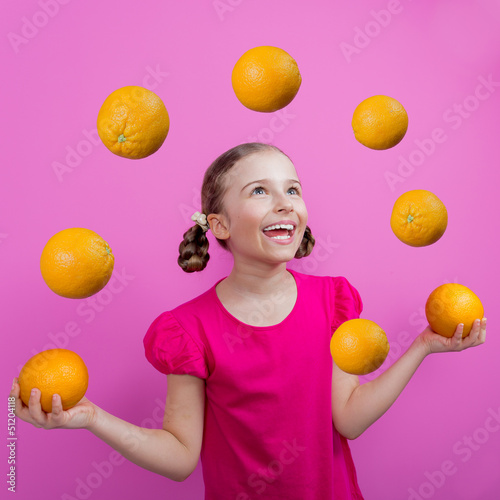 Grapefruit - a young girl juggling grapefruits - diet concept