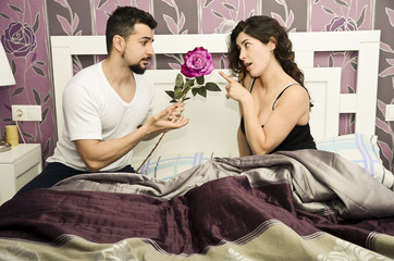 Sorry honey!.Couple in bedroom. Seduction and couples issues.