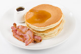 Pancakes, bacon and maple syrup on a white background