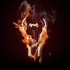 light bulb in fire on black background