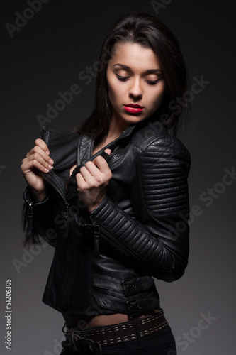 Glamorous woman in black jacket