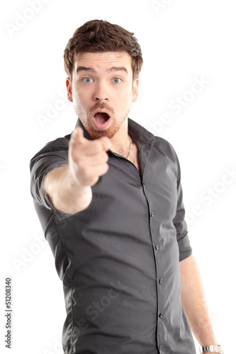 Portrait of smiling handsome man pointing at you over white