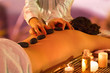 massage with black stones and oil