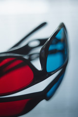 3d anaglyph glasses on reflective background