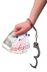 closeup of hand with handcuffs holding money on white background