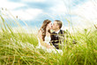 Kissing bride and groom in grass