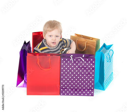 attractive boy with shopping bags