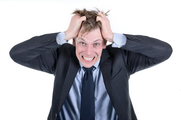 Stressed or desperate businessman pulling his hair out