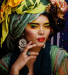 beuty bright woman with creative make up, many shawls on head li