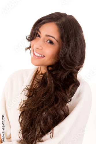 Beautiful woman enjoying with long strong brown hair isolated on