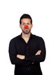 Young businessman with clown nose