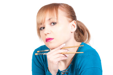beautiful woman waiting a sushi with chopsticks