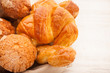 basket of pastries with muffins, croissants