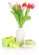 Beautiful tulips in bucket with gifts and cup of tea isolated