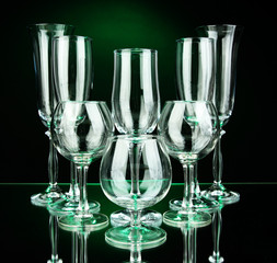 Collection of wine glasses, on dark color background